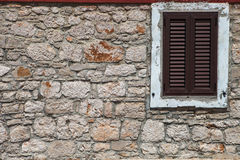 Textured wall with brown shutters Royalty Free Stock Photos