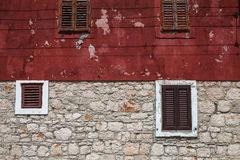 Textured wall with brown shutters Stock Photos