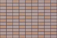 Textured Wall Covered by Tiles of Light Orange, Beige and Flesh Colors Royalty Free Stock Photography