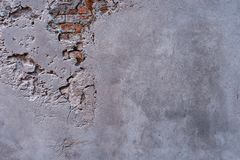 Textured wall with fragments of old red bricks