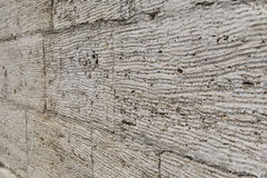 Textured wall of limestone blocks, background Stock Photography