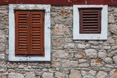 Textured wall with orange shutters Royalty Free Stock Images