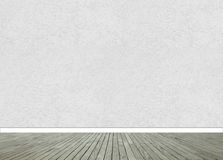 Textured wall with wooden floor panels Stock Image