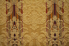 Textured wallpaper. Textured patterned wallpaper; ornate design with raised decorations and woven lines Stock Photo