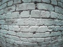 Textured white brick wall, fish eye effect. Toned royalty free stock photo