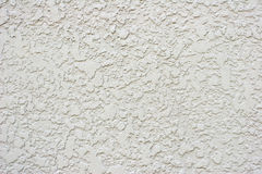 Textured White or Grey Stucco Wall With Small Crac. Close up of stucco textures on light colored wall Royalty Free Stock Photo
