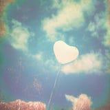 Textured White Heart Balloon. White Heart balloon over turquoise sky stock photography