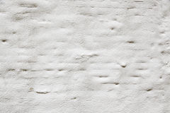 Textured white wall. White wall with texture, detail front on top of a wall Stock Image