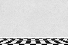 Textured white wall with black and white checkered floor Royalty Free Stock Photo