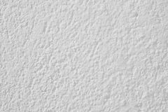 Textured white wall detail. Abstract background. Copy space. Stock Photos