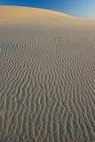 Textured windblown sand dune blue sky australia Royalty Free Stock Image
