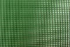 Textured window glass. Green textured window glass close-up Stock Photo
