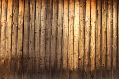 Textured Wood. Old, grainy and rough brown wood wall looking like a textured background Stock Photo