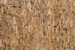 Textured wood stove. sawdust extruded stock images