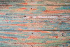 Textured wooden background - grungy weathered wooden surface covered with old blue and red peeling paint.  royalty free stock photos