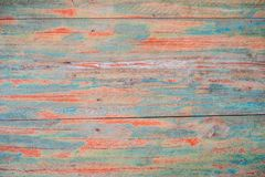 Textured wooden background - grungy weathered wooden surface covered with old blue and red peeling paint.  stock images