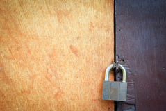 Textured Wooden Door with Padlock Royalty Free Stock Photo