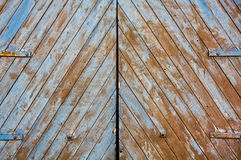 Textured wooden gates. Big wooden castle gates with holders Royalty Free Stock Photography