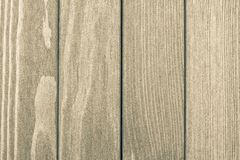 The textured wooden surface of beige color Stock Image