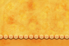 Textured yellow-orange background with flowers Royalty Free Stock Photography