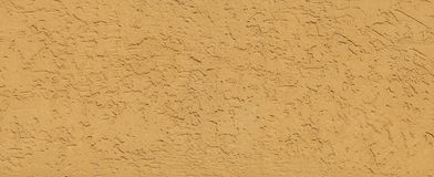 Textured Yellow Plaster Wall Background. Structural Venetian Wall Finish Covering Background. Walled, Decorative Coating Wallpaper. Finishing Stucco Painted Stock Photography