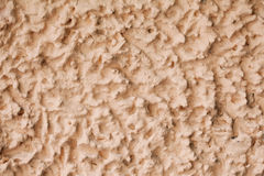 Textured yellow wall background. abstract concrete surface macro view Stock Photo
