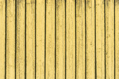 Textured yellow wooden wall Stock Photos