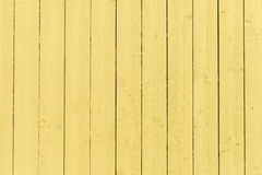 Textured yellow wooden wall Stock Image