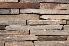 Texturen av den gråa stenhuggeriarbetet Arkivfoton