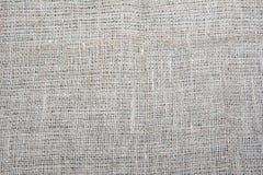 Texturen av den grova torkduken sackcloth Eco tyg naturligt Bakgrund Arkivbilder