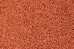 Texturen av en rubber asfalt för rubber smula används i stadion för rinnande spår Fotografering för Bildbyråer