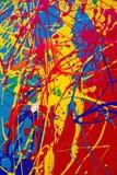 Texturen av färgstänk av mång--färgade målarfärger arkivbilder