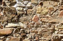 Texturen av gamla stenar och tegelstenar samman med cement Royaltyfri Fotografi