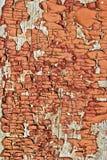Texturen av gammalt som är sprucken, målarfärg på ett träbräde. Arkivfoton