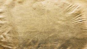 Texturen av gulden Guld- material, yttersida, bakgrund Närbild Arkivfoto