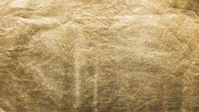 Texturen av gulden Guld- material, yttersida, bakgrund Närbild Royaltyfri Foto