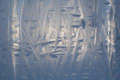 Texturen av isen med utskrivavna modeller Arkivfoton