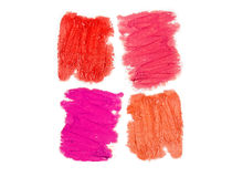 Texturen av läppstiftet av olika färger som isoleras på whit Royaltyfri Bild