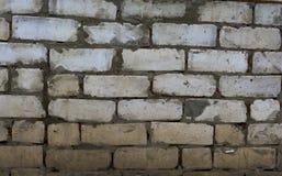 Texturen av murverket Ungefärligt staplade tegelstenar bakgrund boards horisontalknotty sörjer textur Royaltyfria Foton