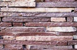 Texturen av stenfasaden Arkivbilder