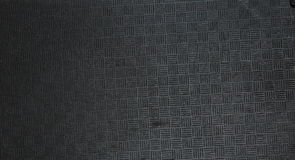 Texturen av svart plast- med notchesn Royaltyfri Foto