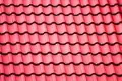 Texturen av taket för röd tegelplatta Arkivbilder
