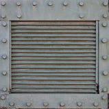 Texturen av väggen av behållaren som göras av metall och förstärks med en mängd av bultar och nitar Bilder av beläggningen av Fotografering för Bildbyråer