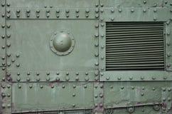 Texturen av väggen av behållaren som göras av metall och förstärks med en mängd av bultar och nitar Bilder av beläggningen av Royaltyfri Fotografi
