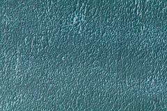 Texturen av väggmålningen i härlig aqua Nära övre för skott royaltyfri bild