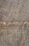 Textureon de la arpillera un fondo de madera, rústico, la Navidad Materia textil de la tela del modelo Fondo de la textura Fotos de archivo libres de regalías