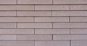 Texturera av den beige tegelstenväggen arkivfoto