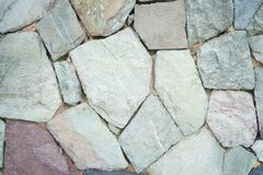 Texturera av en stenv?gg Gammal bakgrund f?r textur f?r slottstenv?gg royaltyfria foton