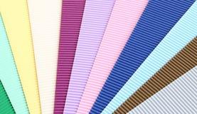 Texturera av färgar korrugerat skyler över brister Arkivfoto