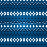 Texturera av olik rhombus på en blåttbakgrund Arkivfoton